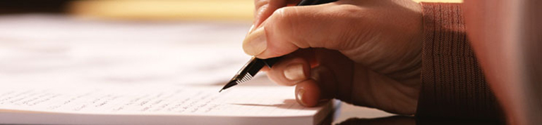 A person working out their tax with a pen and paper